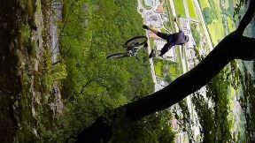 Downhill Mountain Biker Throws Himself Off A Cliff