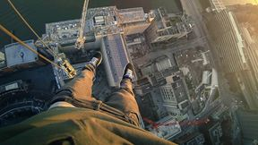 James Kingston scales a crane atop the Southbank Tower